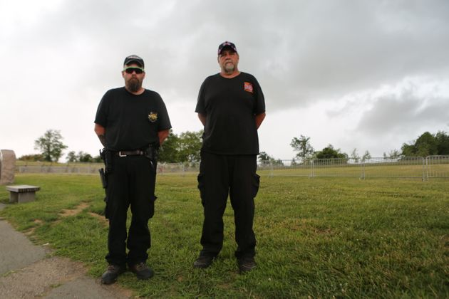 Billy Snuffer (right), the Imperial Wizard for the Rebel Brigade of the Knights of the Ku Klux Klan, stands on the Gettysburg Battlefield with another Klan member.