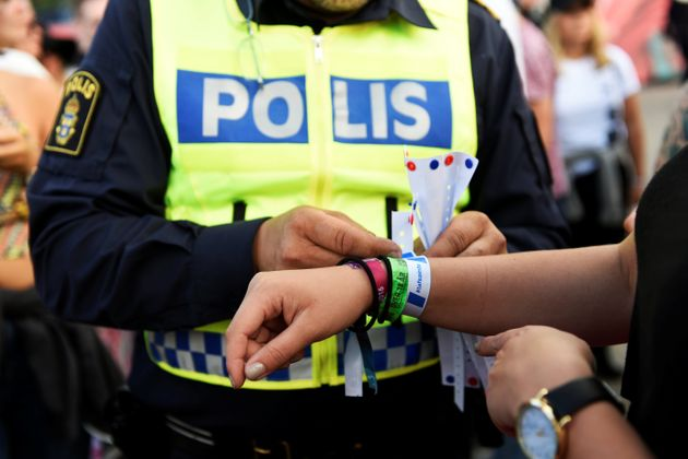 Police officers handed out bracelets with the words