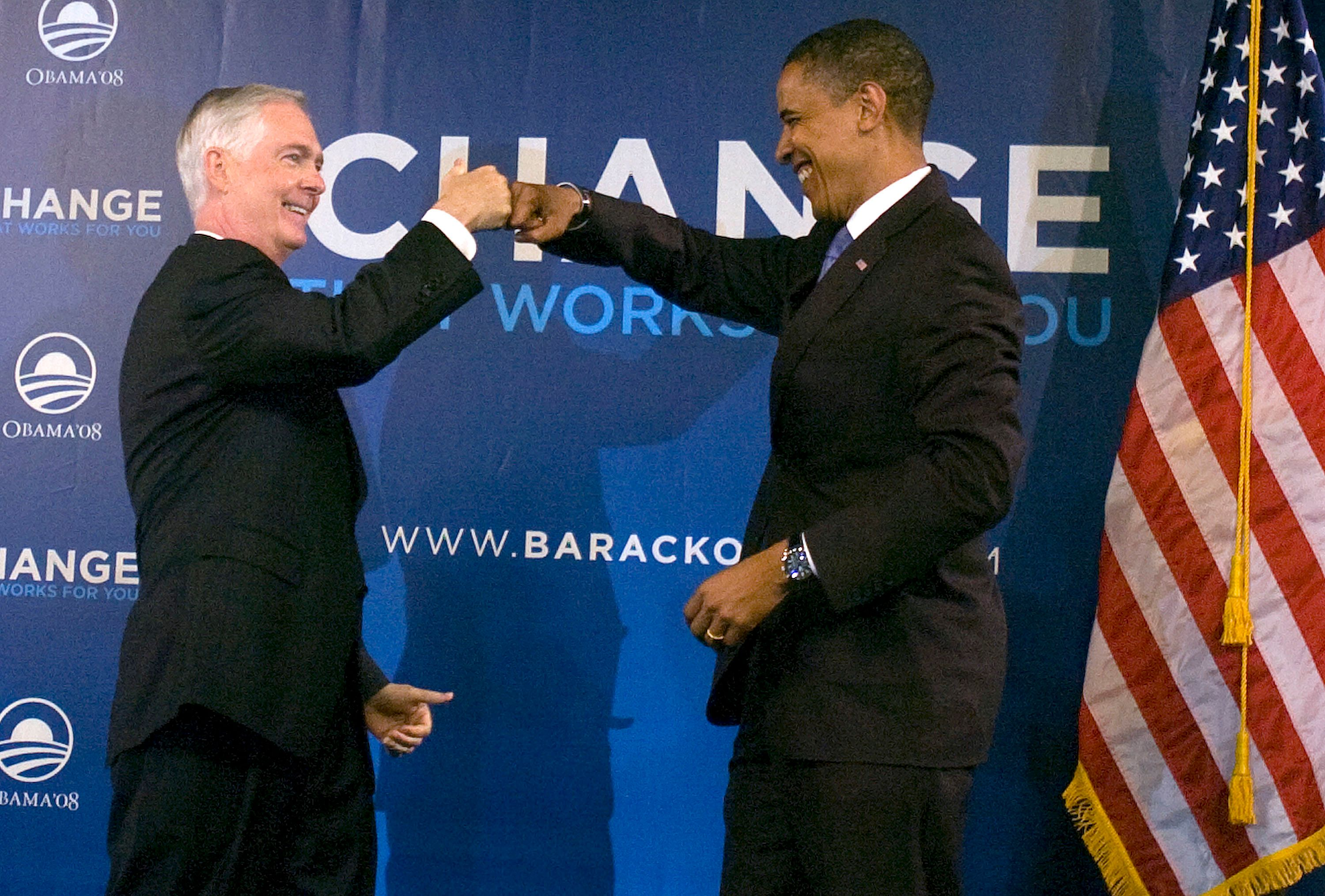 Gov. Mike Easley, left, bumps fists with Democratic presidential candidate Sen. Barack Obama after introducing him to an invitation-only audience at the state fairgrounds, Monday, June 9, 2008, in Raleigh, North Carolina.  (Photo by Shawn Rocco/Raleigh News & Observer/MCT via Getty Images)