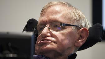 British scientist Stephen Hawking attends the launch of The Leverhulme Centre for the Future of Intelligence (CFI) at the University of Cambridge, in Cambridge, eastern England, on October 19, 2016. The Leverhulme Centre for the Future of Intelligence (CFI), which launched today, is a collaboration between the University of Cambridge, the University of Oxford, Imperial College London, and the University of California, Berkeley. The centre will explore the implications of the rapid development of artificial intelligence (AI). / AFP / NIKLAS HALLE'N        (Photo credit should read NIKLAS HALLE'N/AFP/Getty Images)