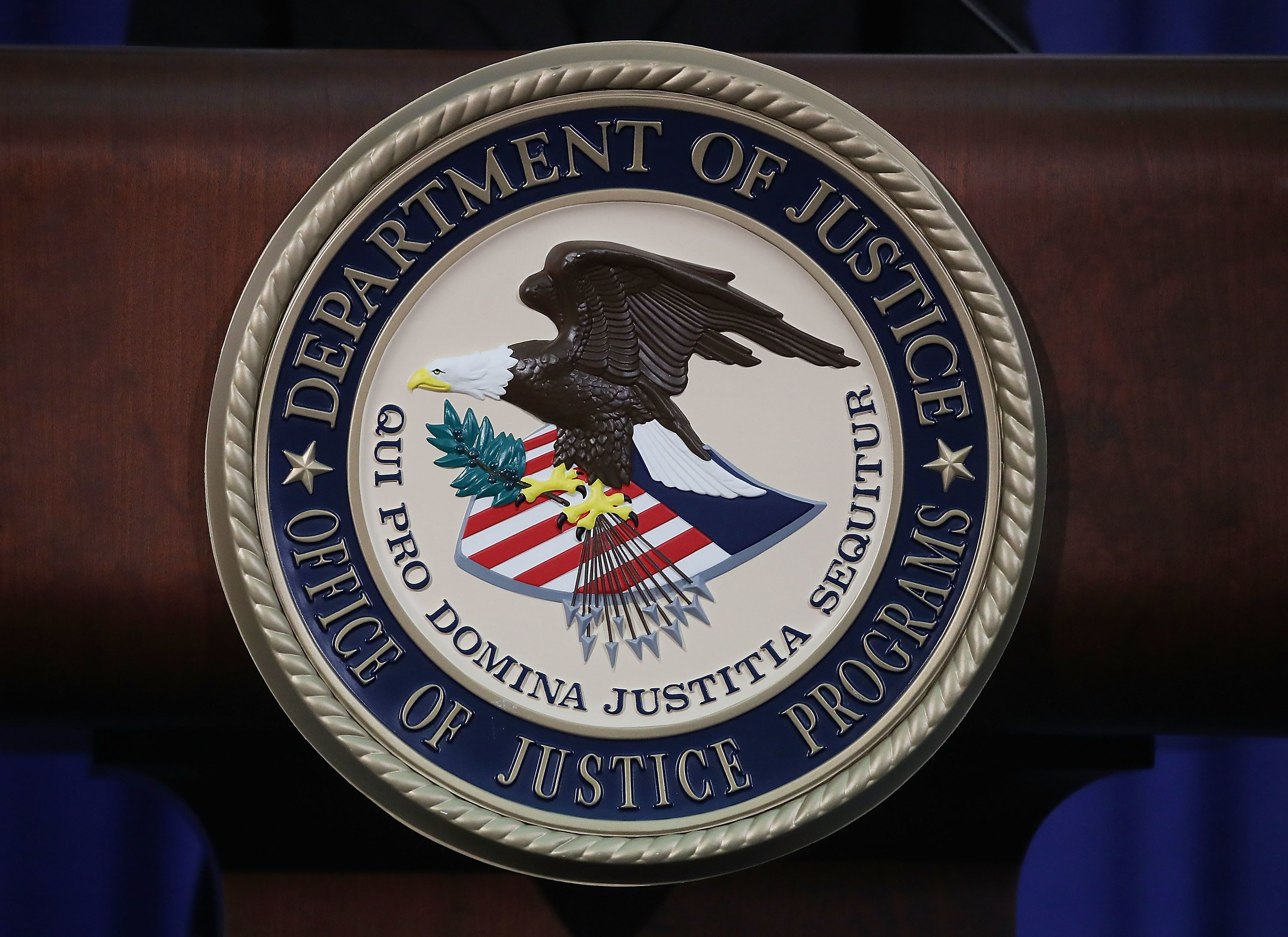 WASHINGTON, DC - JUNE 29: The Justice Department seal is seen on the lectern during a Hate Crimes Subcommittee summit on June 29, 2017 in Washington, DC. The meeting gave stakeholders the opportunity to offer imput to the committee before it makes its recommendations to the attorney general on what the Department of Justice can do to improve reporting, investigation and prosecution of hate crimes.  (Photo by Mark Wilson/Getty Images)