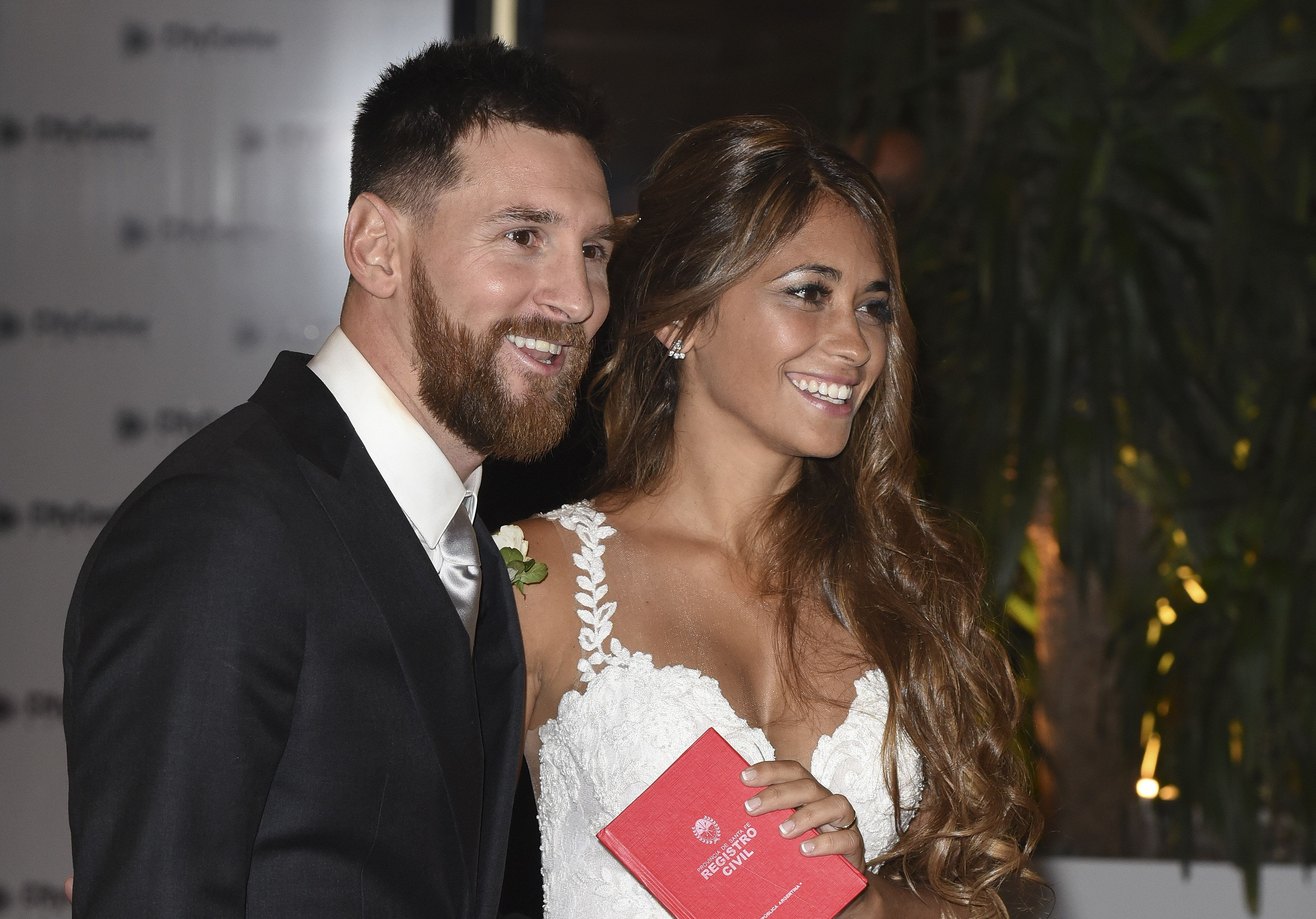 Lionel Messi and Antonela Roccuzzo greet the press after their civil wedding ceremony at the City Center...