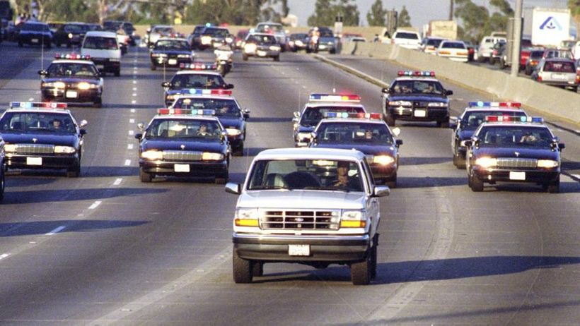 """""""California Highway Patrol units chase Al Cowlings, who is driving the  white Bronco, and O.J. Simpson, hiding in the rear, o"""