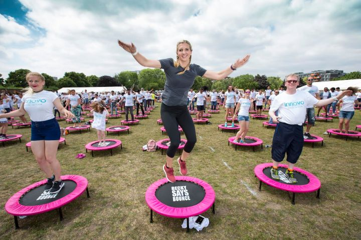 Olympian Rebecca Adlington helped Innovo to break a world record title for the most people bouncing on trampolines.