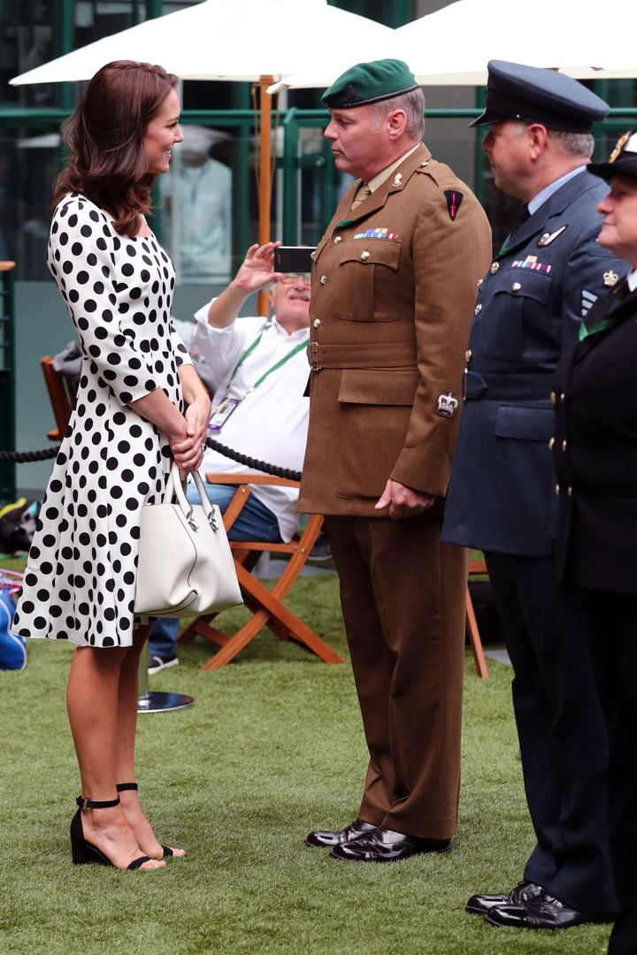 Catherine, Duchess of Cambridge, meets with servicemen and servicewomen as she visits The All England Lawn Tennis Club in Wimbledon, south-west London, on 3 July 2017 on the first day of the 2017 Wimbledon Championships.