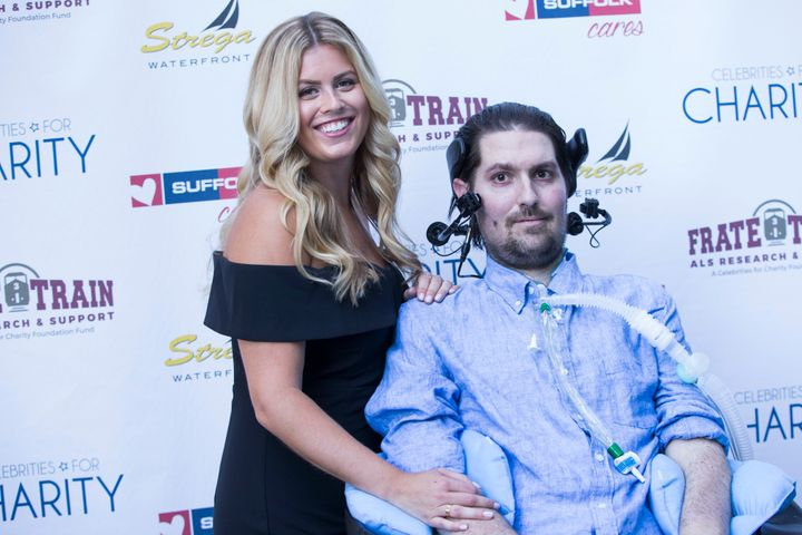 Julie Frates holds her husband, Pete Frates, at a fundraiser duringALS Awareness Month in Boston last August.