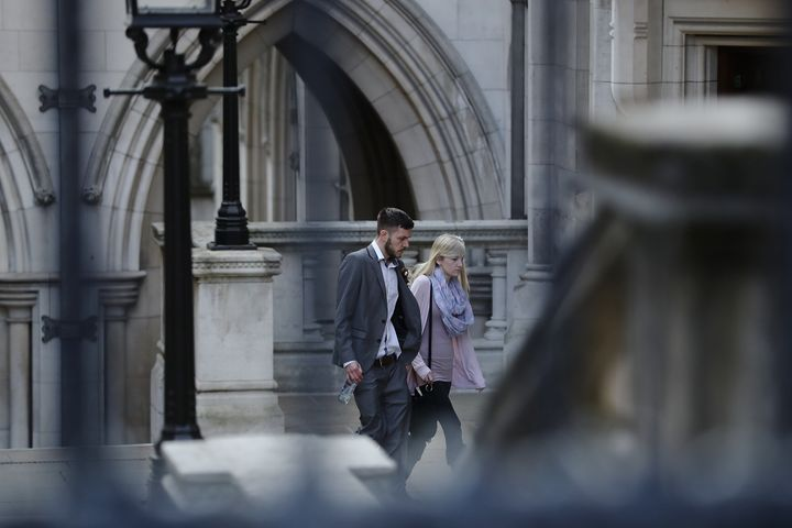 The parents of Charlie Gard, Chris Gard and Connie Yates, walk through the grounds of the Royal Courts of Justice on April 7