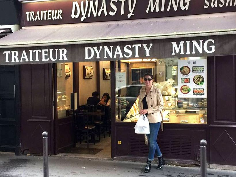 Standing outside of the Dynastry Ming restaurant, one of my favorite places to grab take-out in Paris.