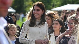 LONDON, UNITED KINGDOM - MAY 13: Catherine, Duchess of Cambridge meets guests at a tea party in the grounds of Buckingham Palace to honour the children of those who have died serving in the armed forces on May 13, 2017 in London, England. (Photo by Andrew Parsons - WPA Pool/Getty Images)