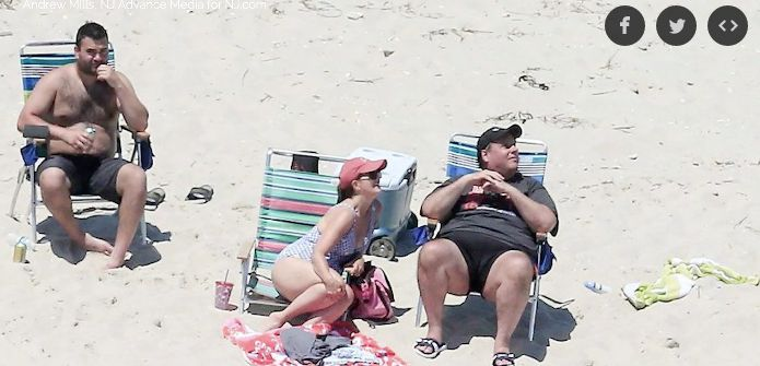 New Jersey Gov. Chris Christie (R) relaxes on the beach he closed to the public.