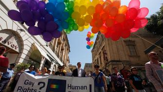 Supporters and members of the lesbian, gay, bisexual and transgender (LGBT) community take part in a gay pride parade organised by the Malta Gay Rights Movement in Valletta June 22, 2013.  The government has said that civil unions for same sex couples will be introduced by the end of the year, according to local media.  REUTERS/Darrin Zammit Lupi (MALTA - Tags: SOCIETY) MALTA OUT. NO COMMERCIAL OR EDITORIAL SALES IN MALTA