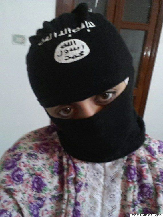 Tareena Shakil wearing a balaclava branded with the ISIS