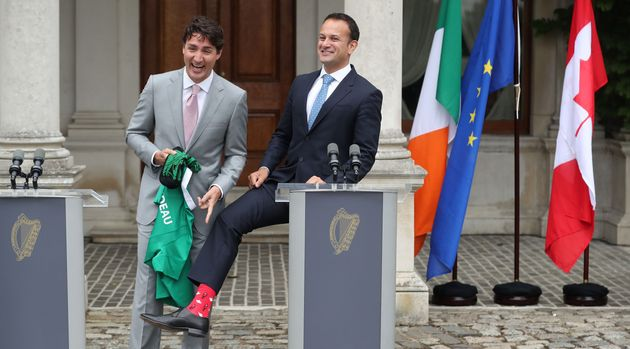 Irish Taoiseach Leo Varadkar, right, showed off his Canadian-themed socks during a press conference with...