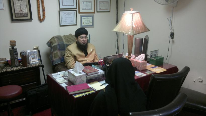 Mufti Muneer Akhoon counselling an American Muslim woman at the Islam Center of Hillside Avenue in Queens