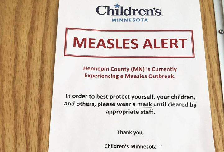 <p>A sign at Children's Minnesota alerts patients to a measles outbreak. </p>