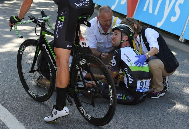 Dimension Data rider Mark Cavendish of Britain gets medical assistance after his crash next to the finish...