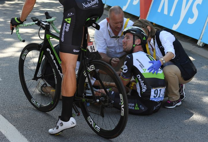 Dimension Data rider Mark Cavendish of Britain gets medical assistance after his crash next to the finish line in Vittel, Fra
