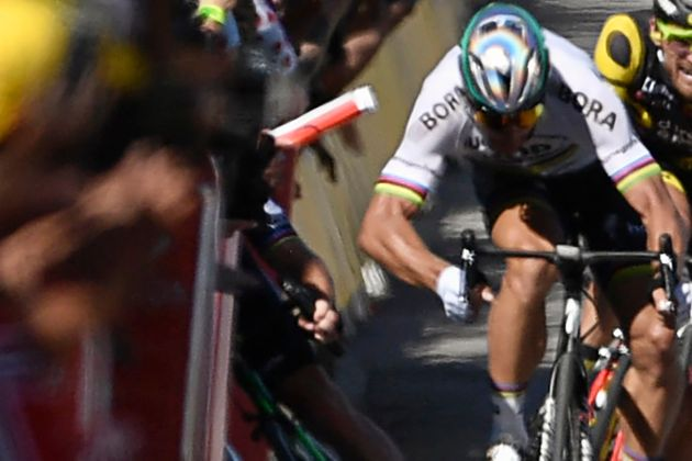 Slovakia's Peter Sagan is seen with his elbow out after hitting Great Britain's Mark Cavendish, causing...