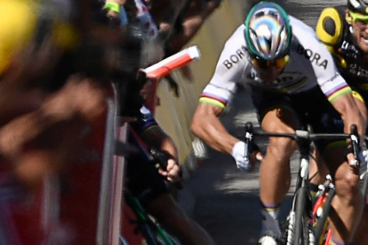 Slovakia's Peter Sagan is seen with his elbow out after hitting Great Britain's Mark Cavendish, causing him to fall into a ba