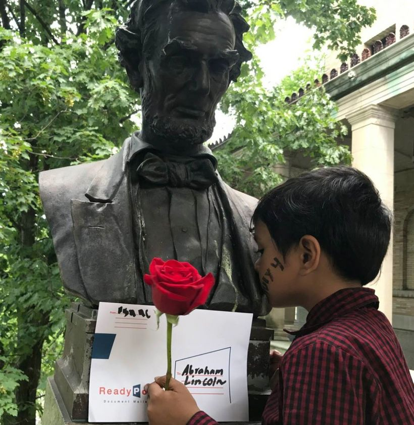 Isaac giving a kiss on the statue of President Abraham Lincoln.