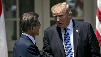 U.S. President Donald Trump, right, shakes hands with Moon Jae-in, South Korea's president, during a joint statement in the Rose Garden of the White House in Washington, D.C., U.S., on Friday, June 30, 2017. Trump wants South Korea to reduce barriers to U.S. auto exports to the country and is concerned by the 'enormous' amount of surplus steel the U.S. imports from the country, especially shipments that come via China, a White House administration official said this week. Photographer: Andrew Harrer/Bloomberg via Getty Images