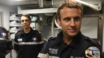 In this photograph taken at sea on July 4, 2017, French president Emmanuel Macron (R) looks on as he stands with crew of the submarine 'Le Terrible' during a visit to the hospital of the vessel.   / AFP PHOTO / POOL / Fred TANNEAU        (Photo credit should read FRED TANNEAU/AFP/Getty Images)
