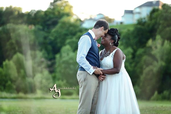 """Dr. Jacob and Aisha Hedges were married on July 1 at Cliff Cave Park pavilion."" -- <i>Ag Photography</i>"