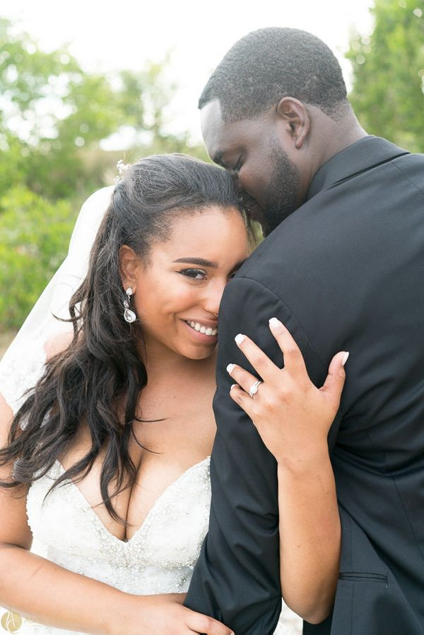 """Gabrielle and Derek Holmes Jr. have tied the knot! These two were married at the Rusty Pelican in Tampa, Florida."" -- <"