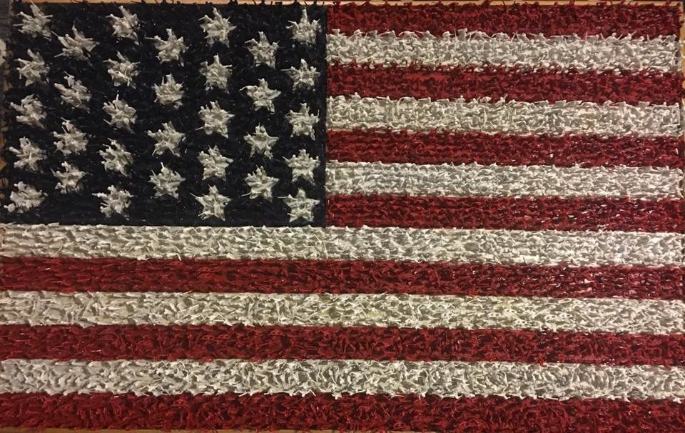 This 5-feet by 3-feet American flag is made up of more than 10000 plastic green Army men