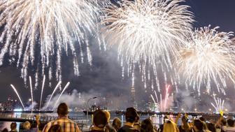 Spectators line New York Citys East River on Tuesday to view the Fourth of July fireworks