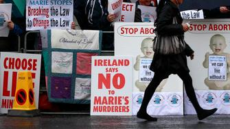 Pro-life campaigners protest outside the Marie Stopes clinic in Belfast October 18, 2012. The first private clinic offering abortions opened in Northern Ireland on Thursday, making access to abortion much easier for women in both Northern Ireland and the Republic of Ireland.    REUTERS/Cathal McNaughton   (NORTHERN IRELAND - Tags: HEALTH SOCIETY)