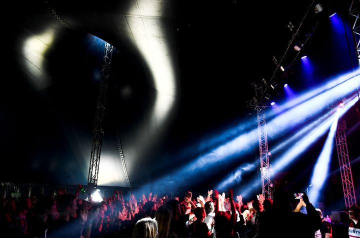 The audience dances during this year'sBravalla Festival in Sweden. Reports of sexual assault and rape at the gathering