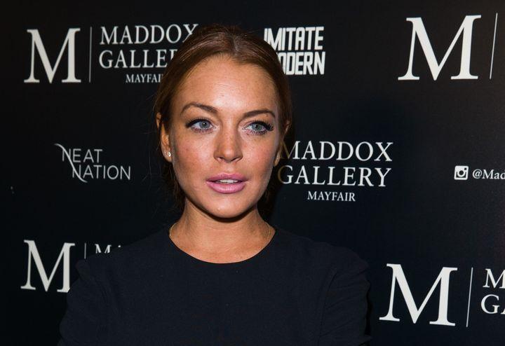 "Lindsay Lohan urged her Twitter followers to ""start trusting"" Donald Trump."