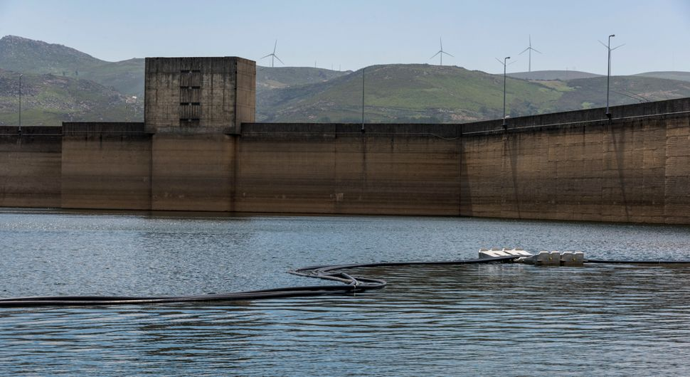 Wires stretch from floating solar panels to Alto Rabagão dam, which produces most of its power with hydroele