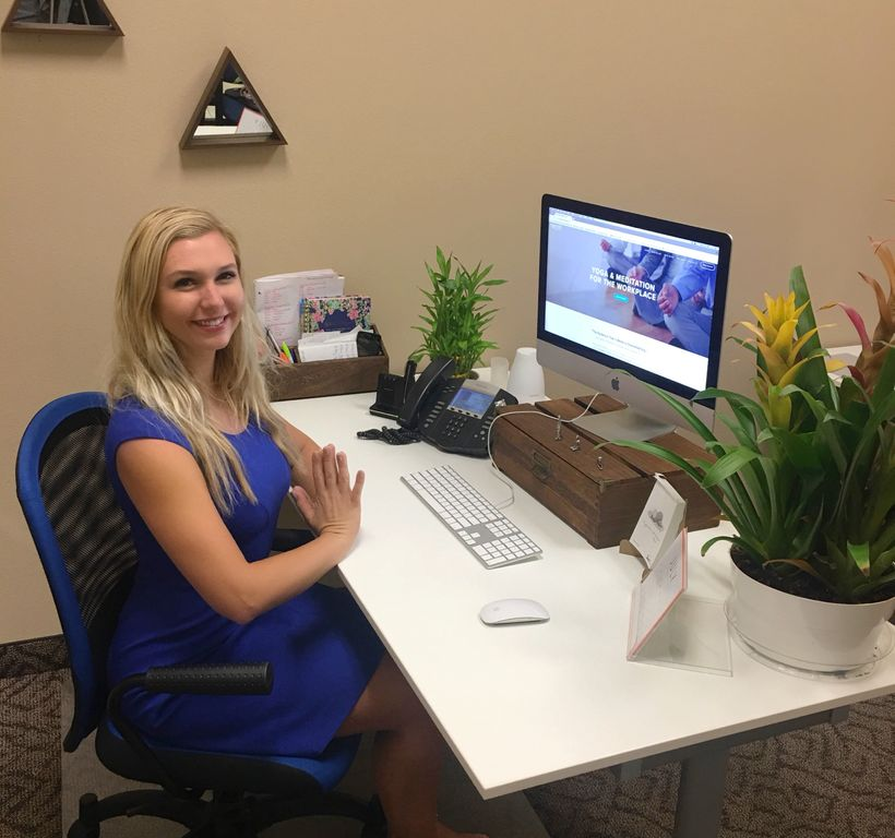 Nomad Corporate Yoga CEO Claudia Padgett at her desk in Las Vegas, Nevada