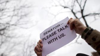 Protesters demonstrate during a rally against U.S. Senator Pat Toomey in Philadelphia, Pennsylvania, U.S. March 1, 2017.  REUTERS/Mark Makela