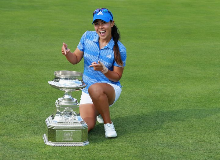 Danielle Kang poses with the trophy after winning the 2017 KPMG Women's PGA Championship at Olympia Fields Country Club on Ju