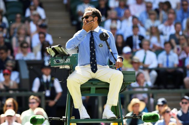 The umpire on centre court reacts as he is surrounded by flying ants during the match between Croatia's...