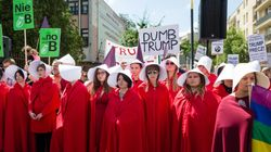 Protesters Dressed As Handmaids To Welcome Trump In