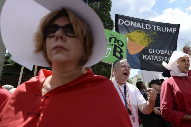 People protest against US President Donald Trump outside the Krasinskich Square in