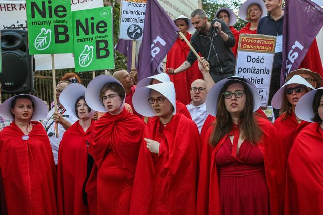 Protestors dressed as handmaids in