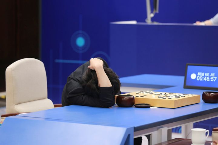 Chinese Go player Ke Jie reacts during his second match against Google's artificial intelligence program. May 25 2017.