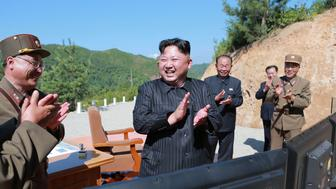 North Korean leader Kim Jong Un reacts with scientists and technicians of the DPRK Academy of Defence Science after the test-launch of the intercontinental ballistic missile Hwasong-14 in this undated photo released by North Korea's Korean Central News Agency (KCNA) in Pyongyang July, 5, 2017. KCNA/via REUTERS ATTENTION EDITORS - THIS IMAGE WAS PROVIDED BY A THIRD PARTY. REUTERS IS UNABLE TO INDEPENDENTLY VERIFY THIS IMAGE. NO THIRD PARTY SALES. SOUTH KOREA OUT.