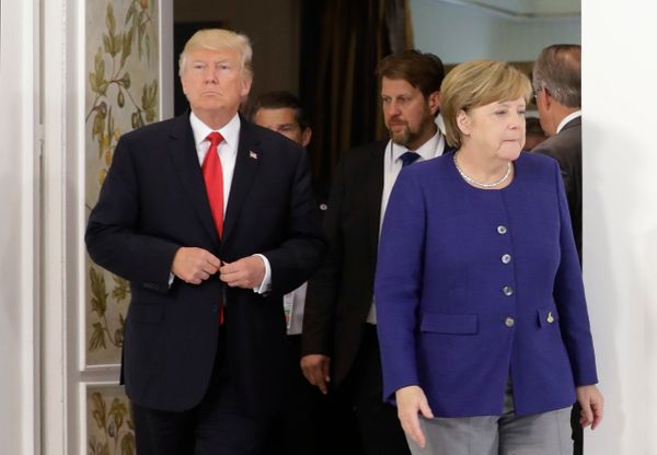 German Chancellor Angela Merkel and U.S. President Donald Trump arrive for a bilateral meeting on the eve of the G-20 summit