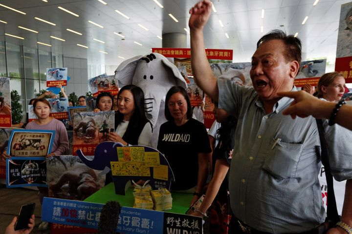 Pro- and anti-ivory trade protesters clash outside a hearing for Hong Kong's new ivory bill on June 6.
