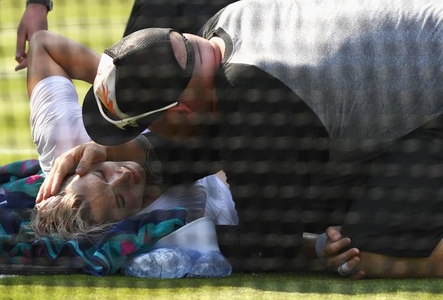 Bethanie Mattek-Sands receives treatment from the medical team on day four of the Wimbledon Lawn Tennis...