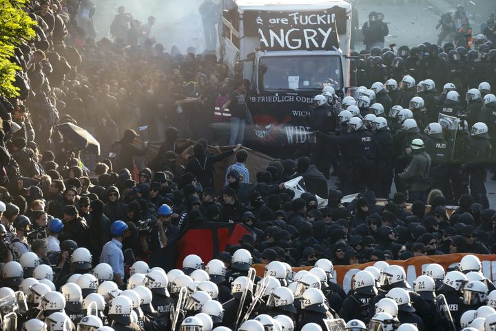 German riot police confront protesters on Thursday during the demonstrations that coincide with the G-20 summit in Hambu