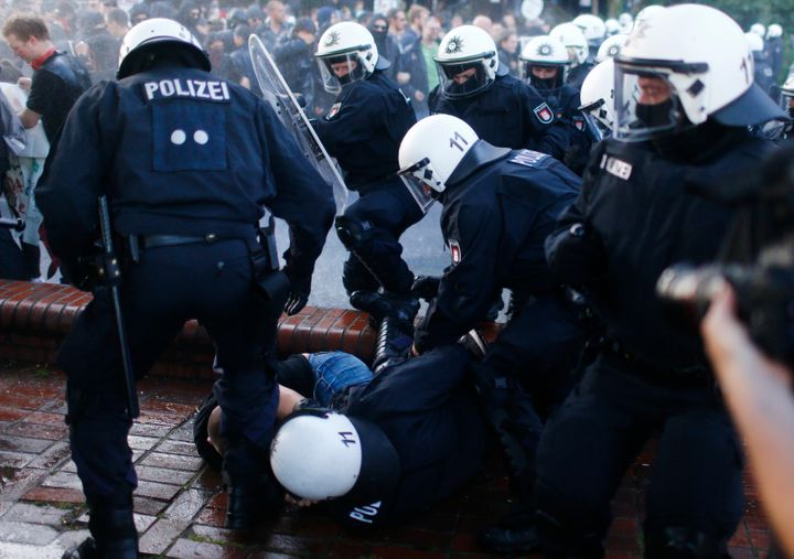 German riot police detain a protester during the demonstrations at the G-20 summit in Hamburg, Germany.
