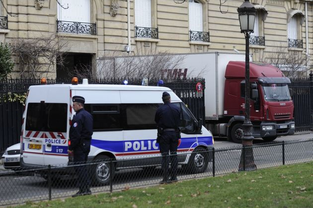 Police officers search Teodorin's Paris residence. Feb. 14,