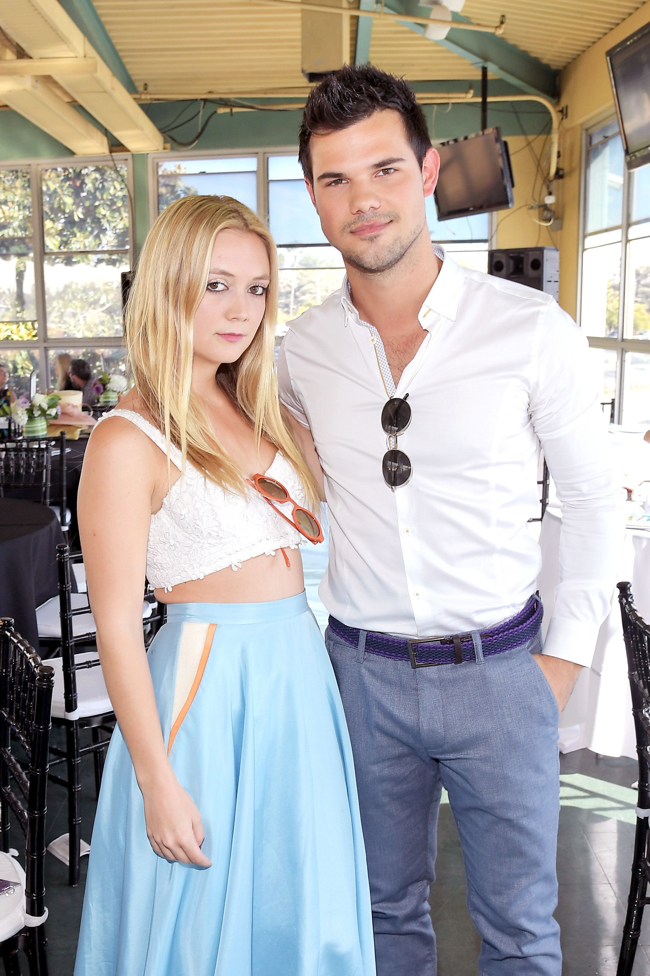 ARCADIA, CA - NOVEMBER 05:  Actors Billie Lourd (L) and Taylor Lautner at the 2016 Breeders' Cup World Championships at Santa Anita Park on November 5, 2016 in Arcadia, California.  (Photo by Charley Gallay/Getty Images for Breeders' Cup)